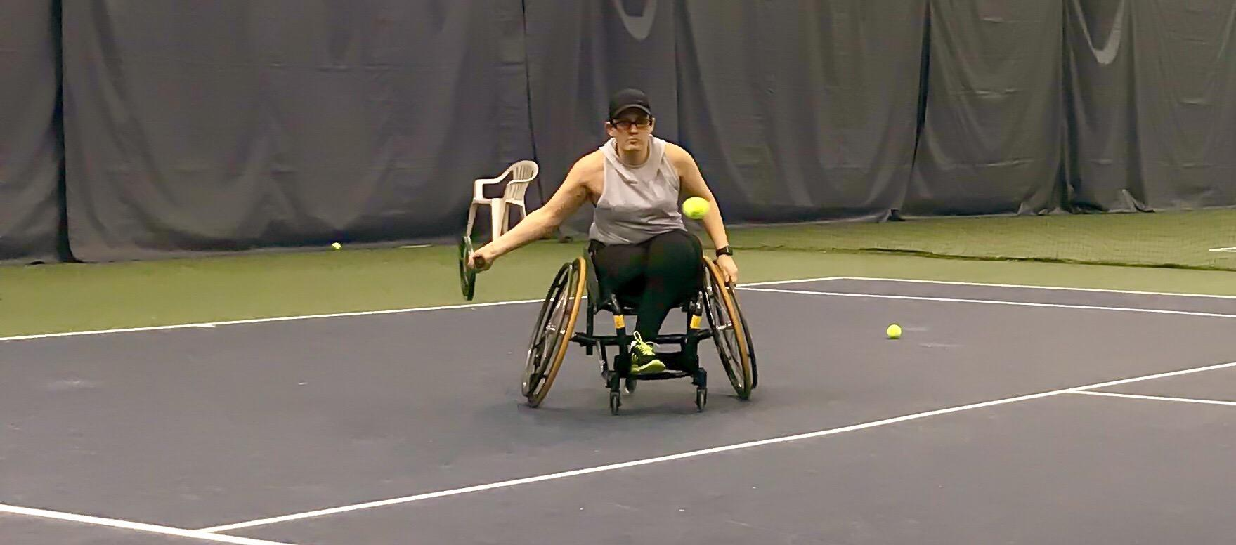 Wheelchair tennis athlete. Click here to play video.