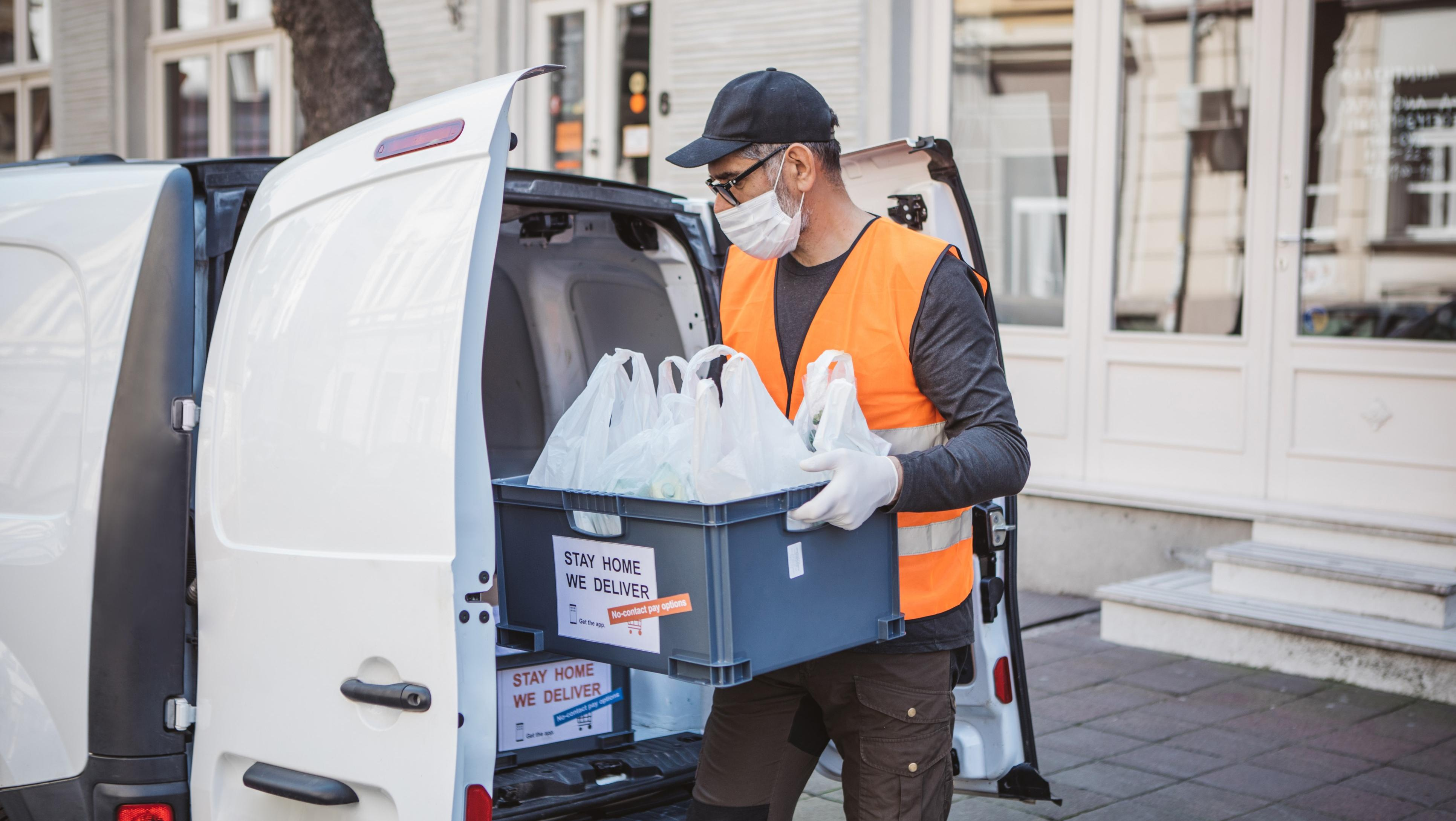 Man loading delivery van