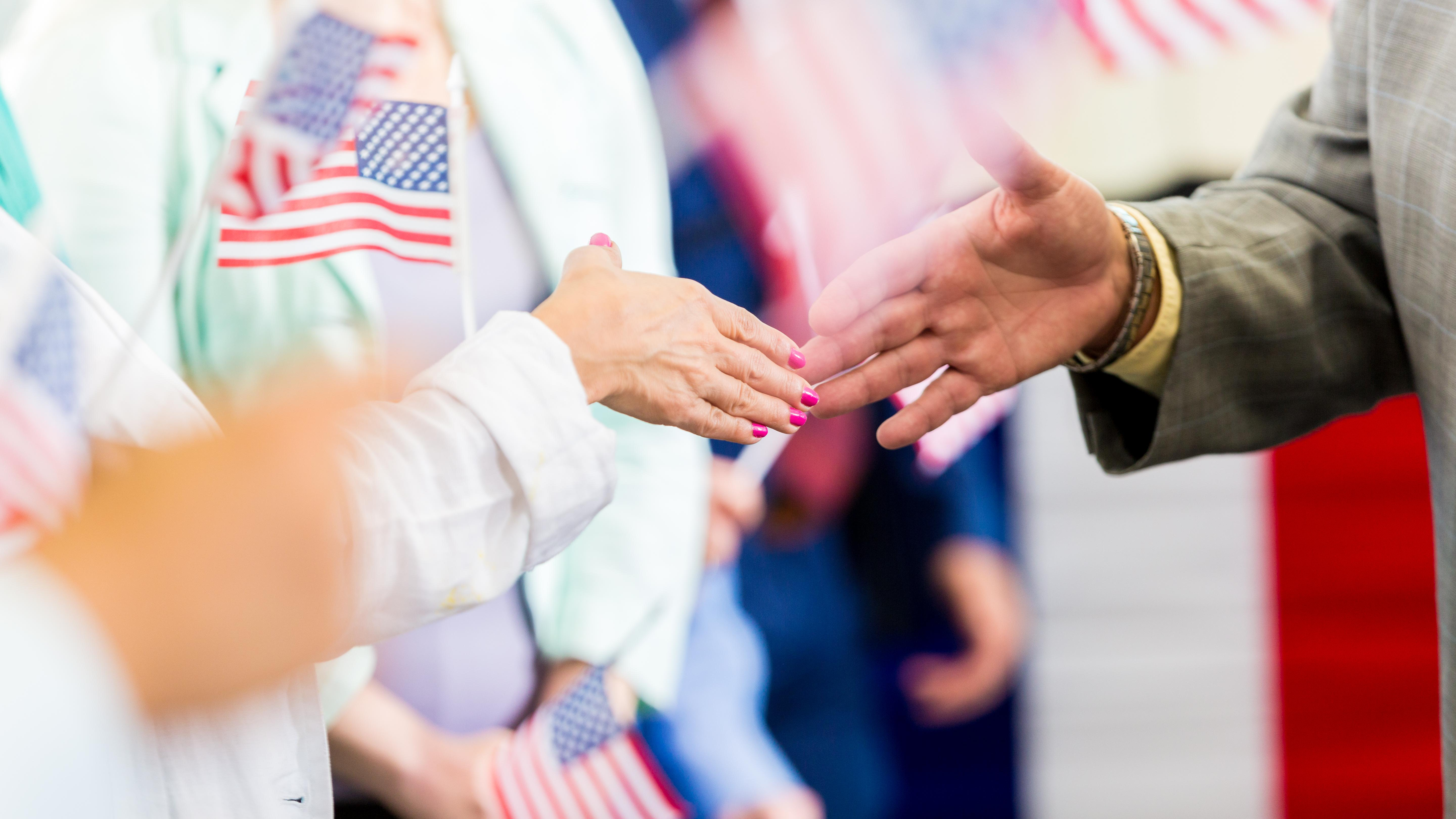 Handshake surrounded by American flags