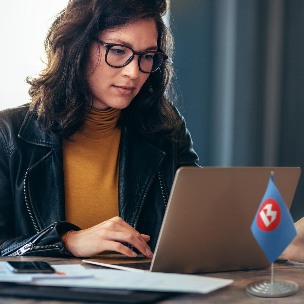 BMO Flag; Asian woman working on laptop